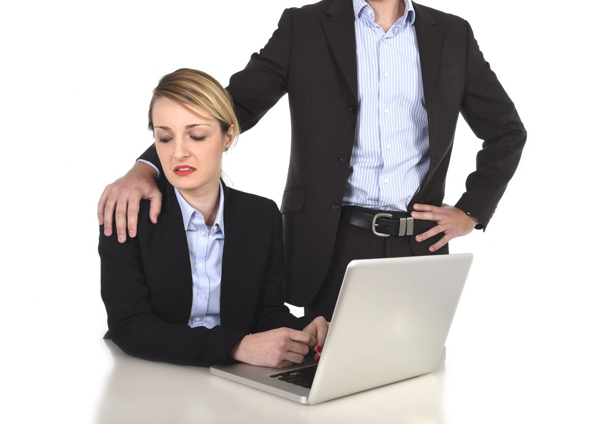 businesswoman suffering work sexual harassment who is in need of legal assistance from an expert Chicago sexual harassment lawyer
