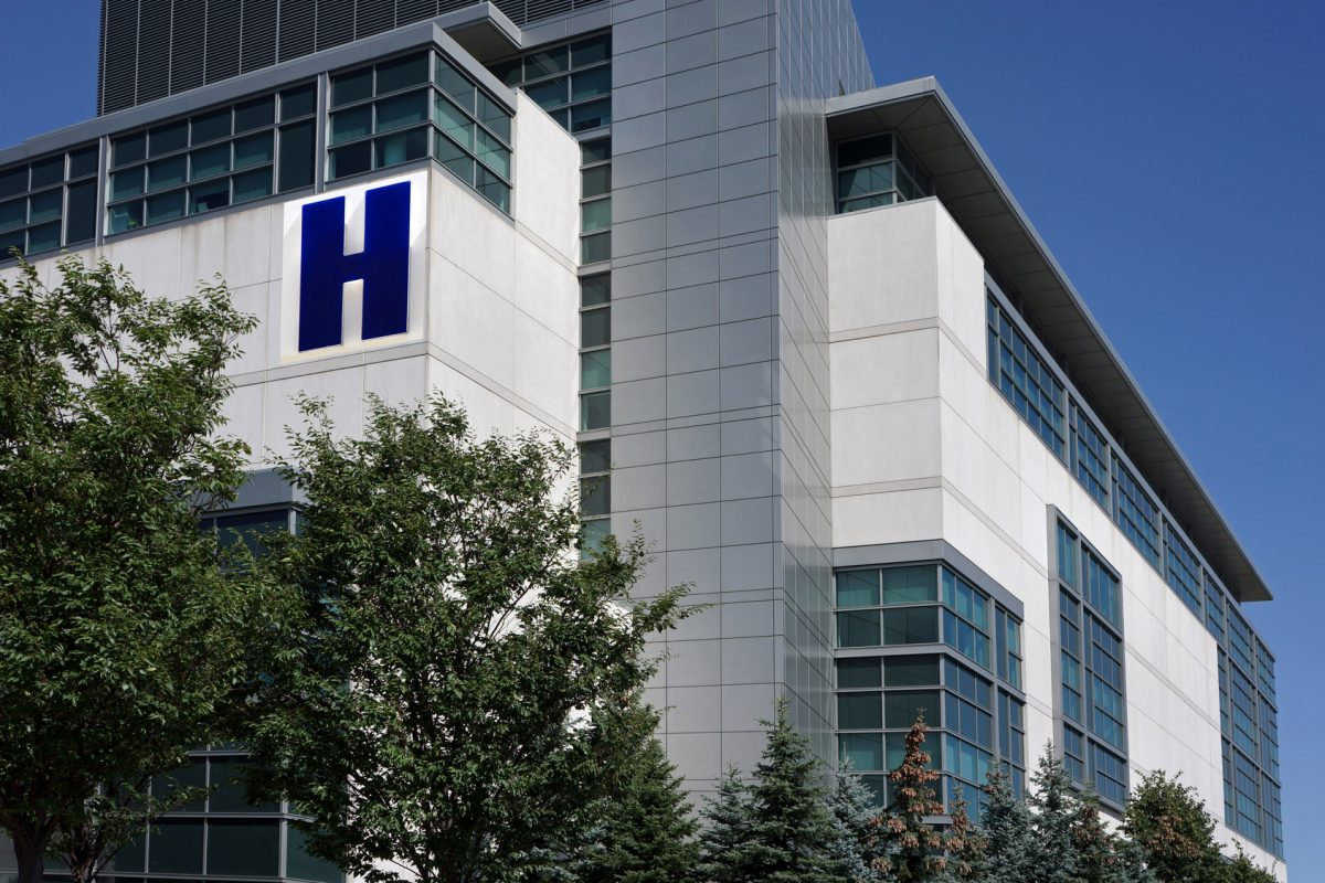 Modern hospital building surrounded by trees after Chicago sexual harassment case handled by harassment attorney Chicago