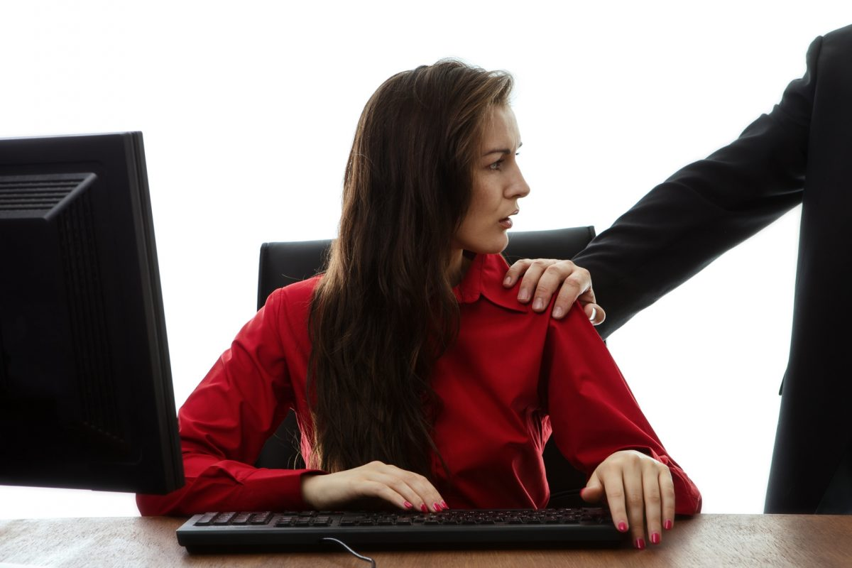 woman experiencing an inappropriate touch at work who is in need of a caring sexual harassment attorney Chicago.