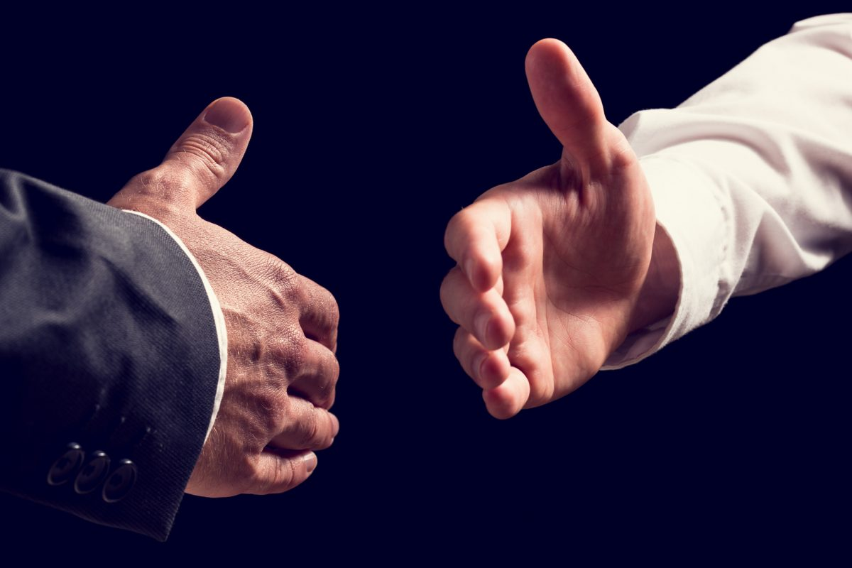two businessmen shake hands after chicago workers compensation attorney wins case