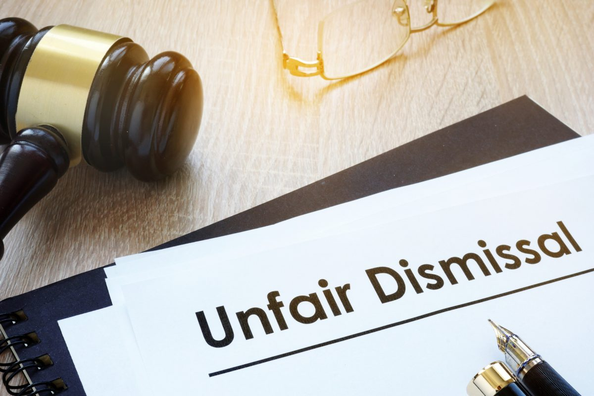 Documents unfair dismissal and gavel in a court and if you need a stellar wrongful termination attorney find one in the Chicago Loop.
