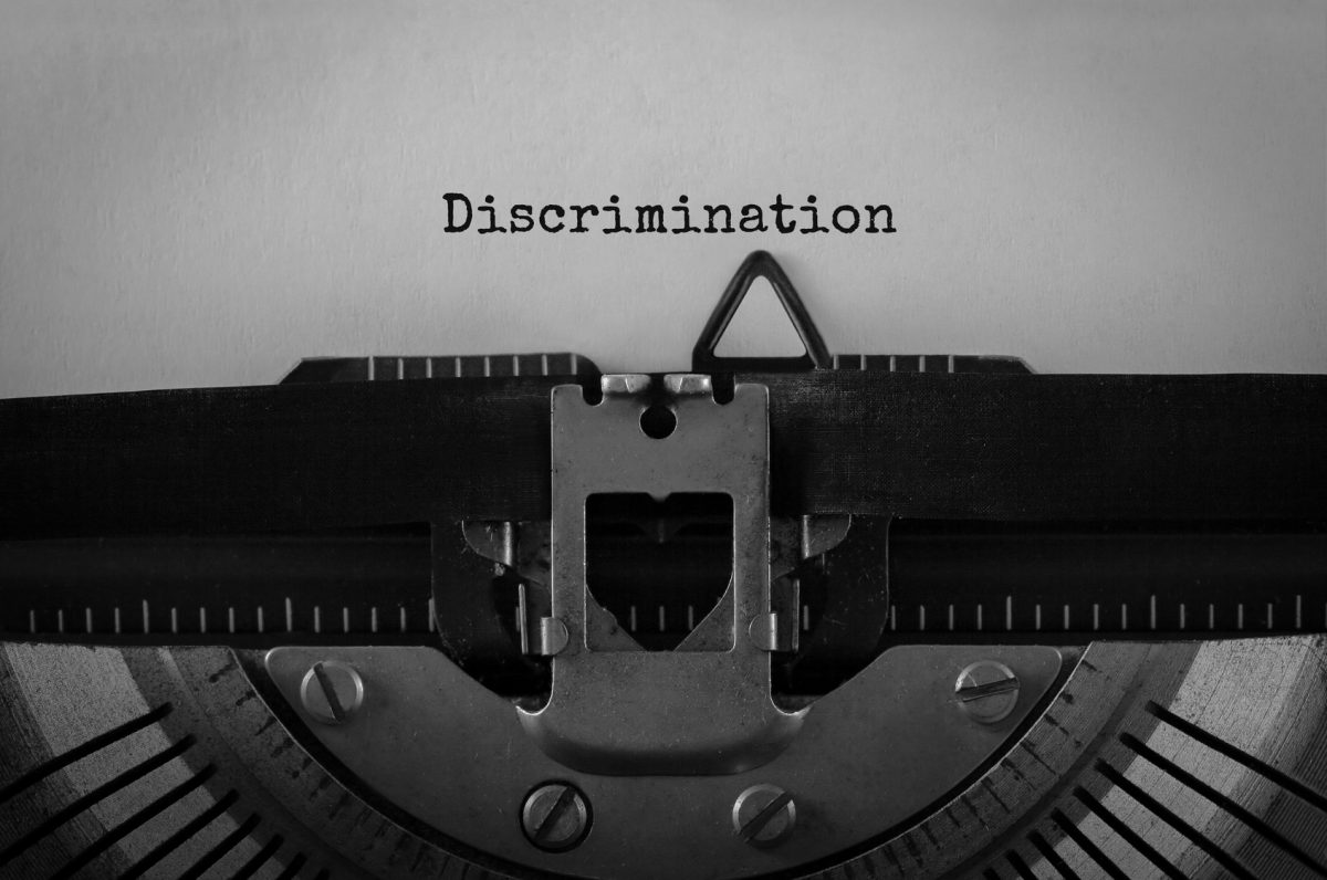 The word discrimination written on a typewriter representing how Mitchell Kline in Chicago can help you if you have been discriminated at work