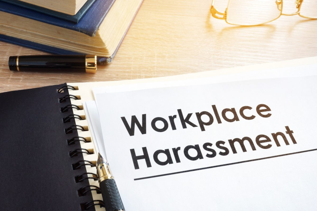Workplace harassment documents on a desk representing how Mitchell Kline can help you with your Chicago workplace harassment case