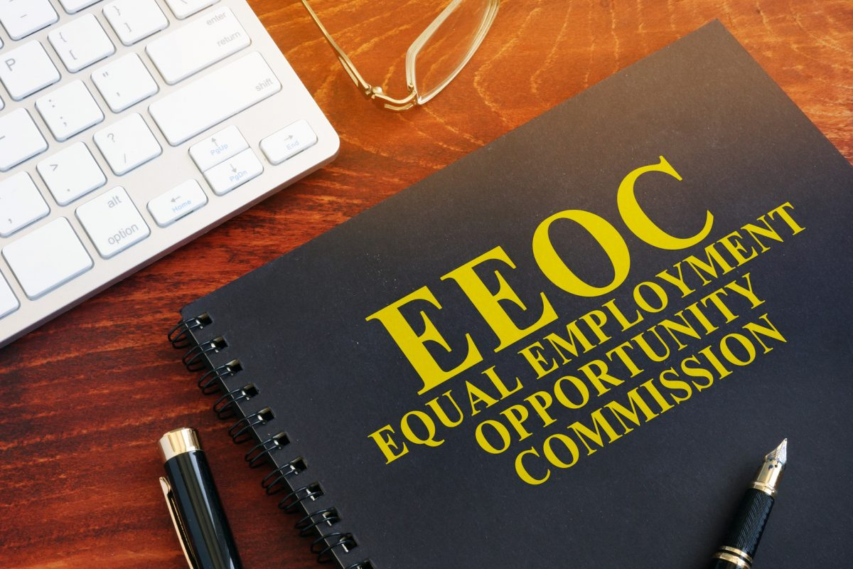 EEOC on desk with keyboard representing how our Chicago Law Firm can assist you with employee retaliation