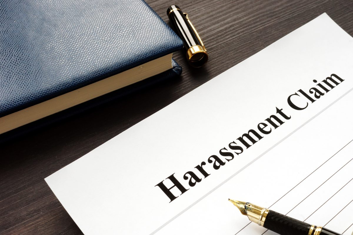 Harassment claim form on table with pen, it is wise to speak to Cook County Sexual Harassment Law Office about your harassment claim in workplace.