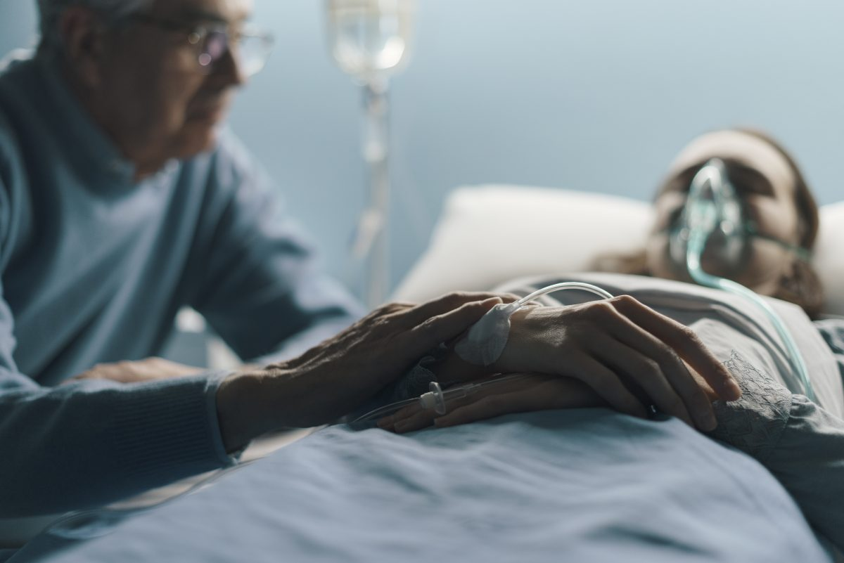 A dad caring for his hospitalized daughter, speak to FMLA Attorney Chicago if you are not receiving your rightful benefits.