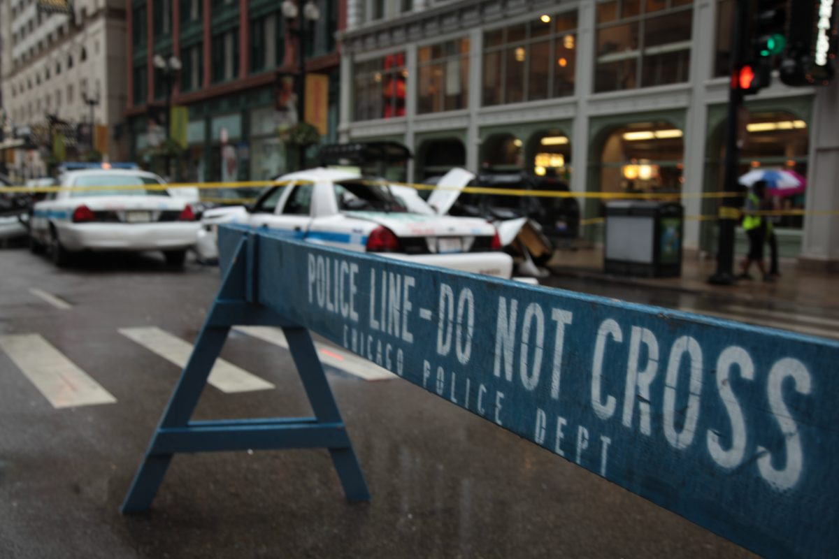 Chicago police barricade with two police cars on street, when you need the Top Employment Law Attorney Chicago to get your rightful pension.