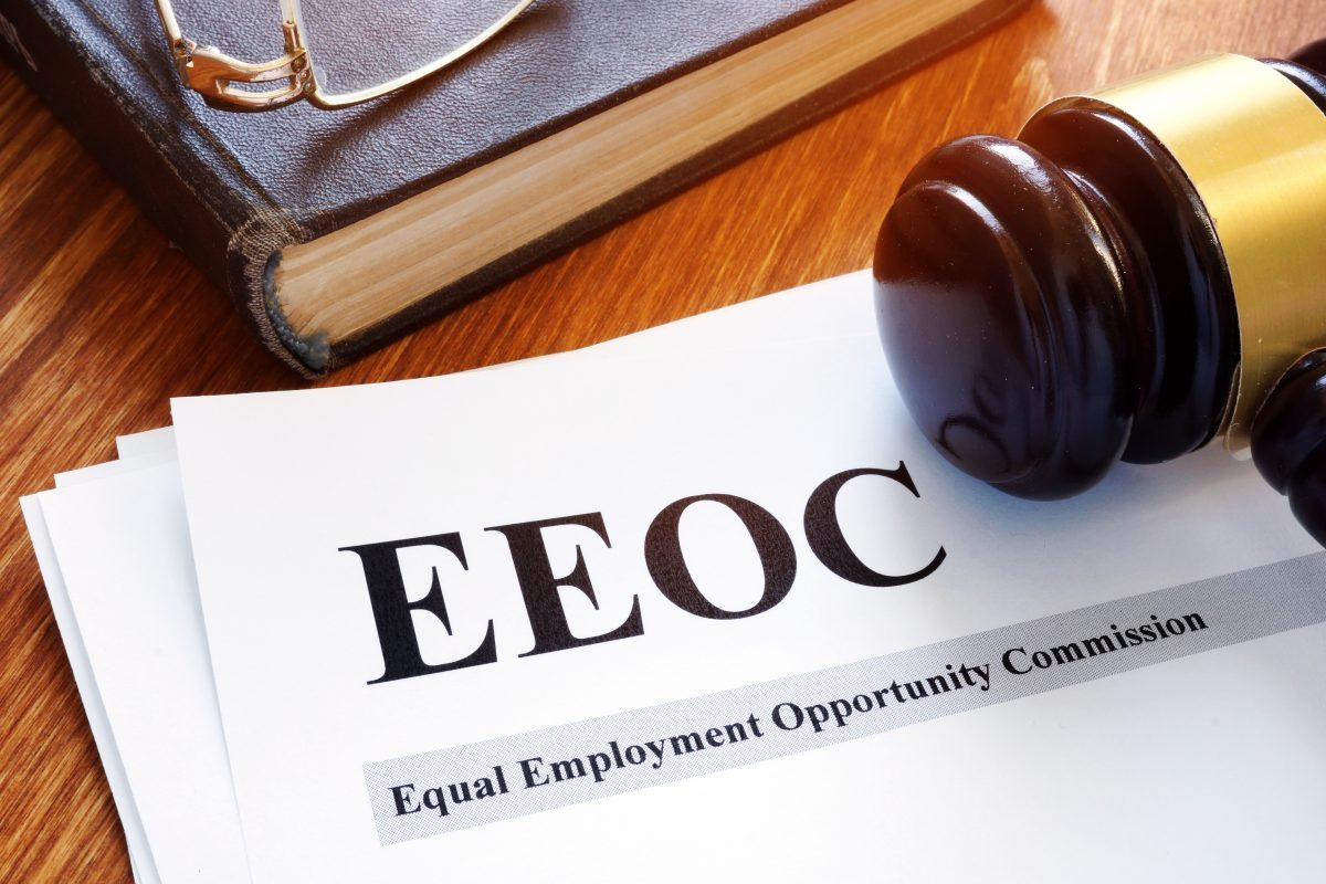 An EEOC document and a gavel on the desk of our Chicago discrimination attorneys.