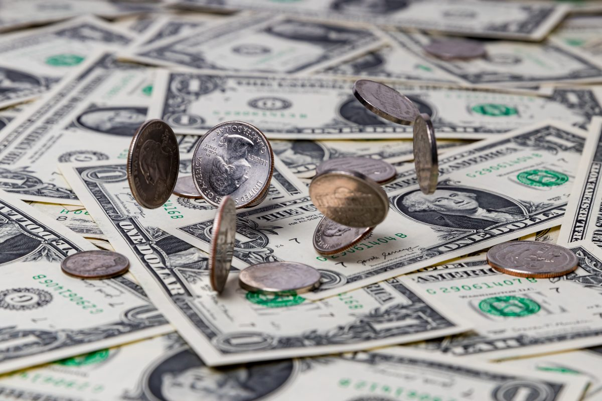 A pile of currency representing how our Chicago employment lawyers can help you navigate wage disputes.