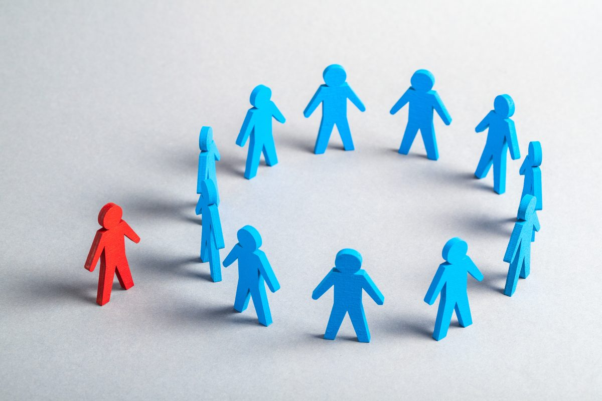 A group of blue human figures in a circle with one red figure outside of the circle representing how our Chicago EEOC attorneys can assist you with your case.